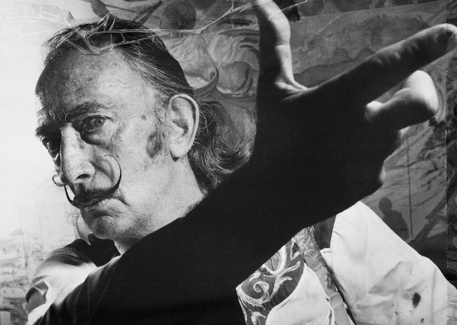 portrait photo of Salvador Dalí gesturing with his hand