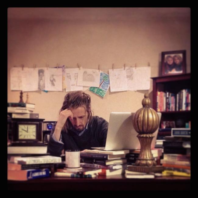 Copyblogger chief copywriter Demian Farnworth sits at his desk straining to write a good syllable