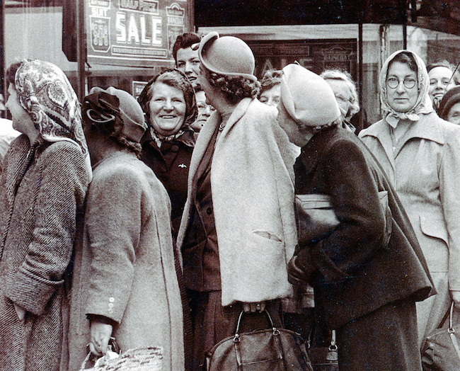 social women standing in line for a sale