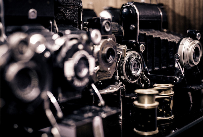 Close-up images of old school cameras