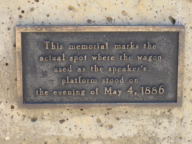 This plaque appears on the memorial statue erected where Samuel Fielden was speaking when the riot broke out.