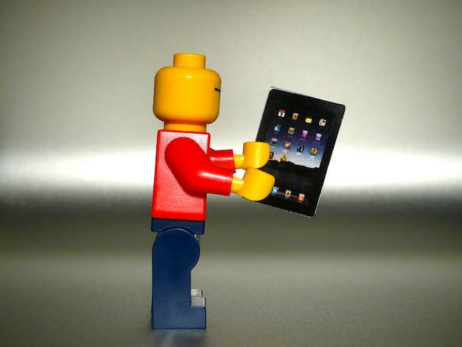 Lego holding a miniature iPad