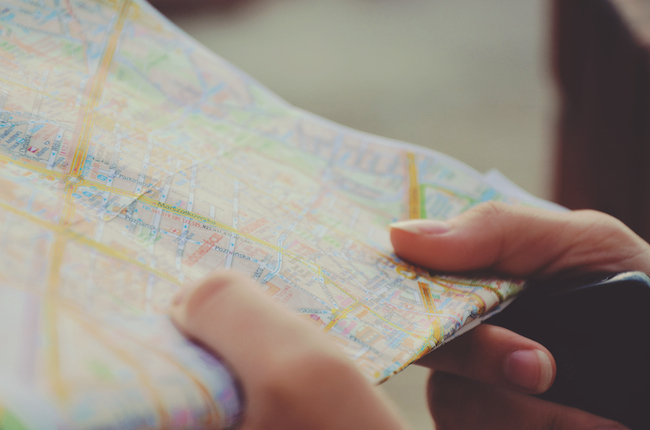 closeup of hands holding a map