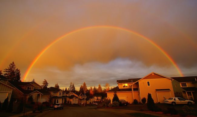 rainbow over a neighborhood of houses