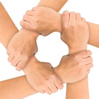 image of five hands linked together