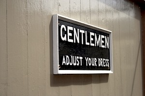 Image of sign: Gentlemen, Adjust Your Dress