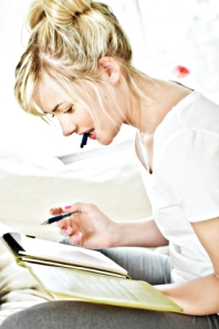 image of woman writing