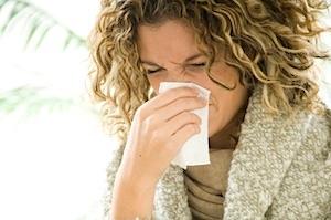 image of woman sneezing