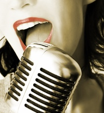 image of singer at the mic